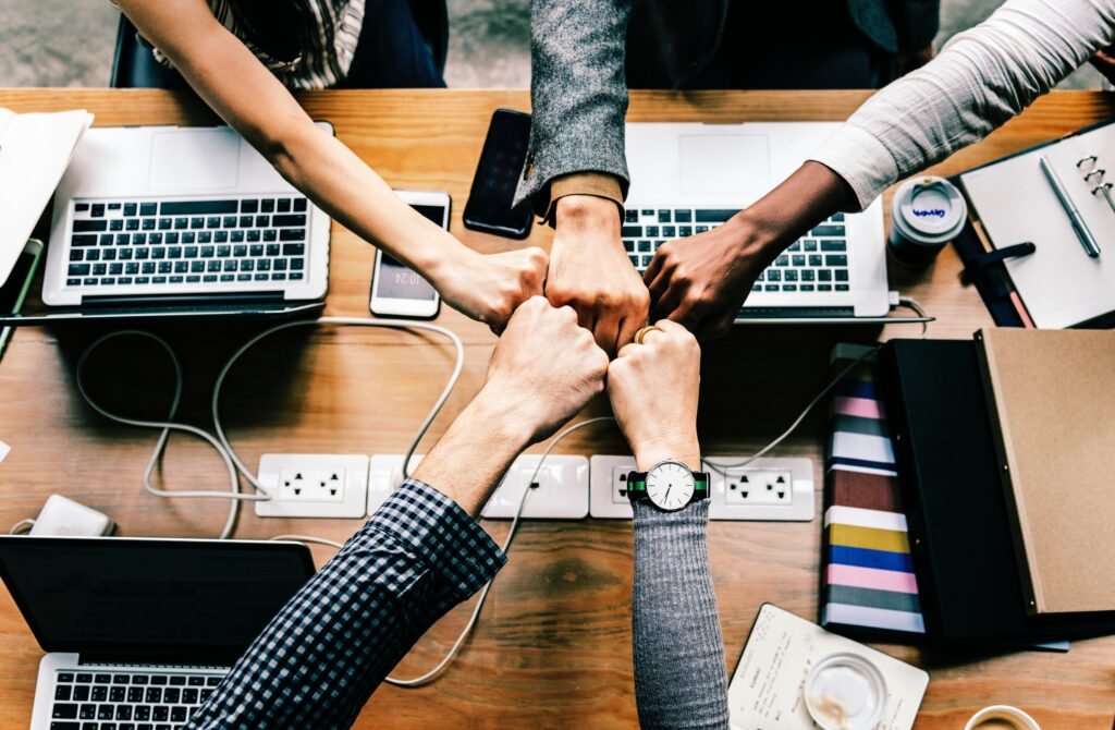 Hands Knuckle-touching together as part of strong company culture